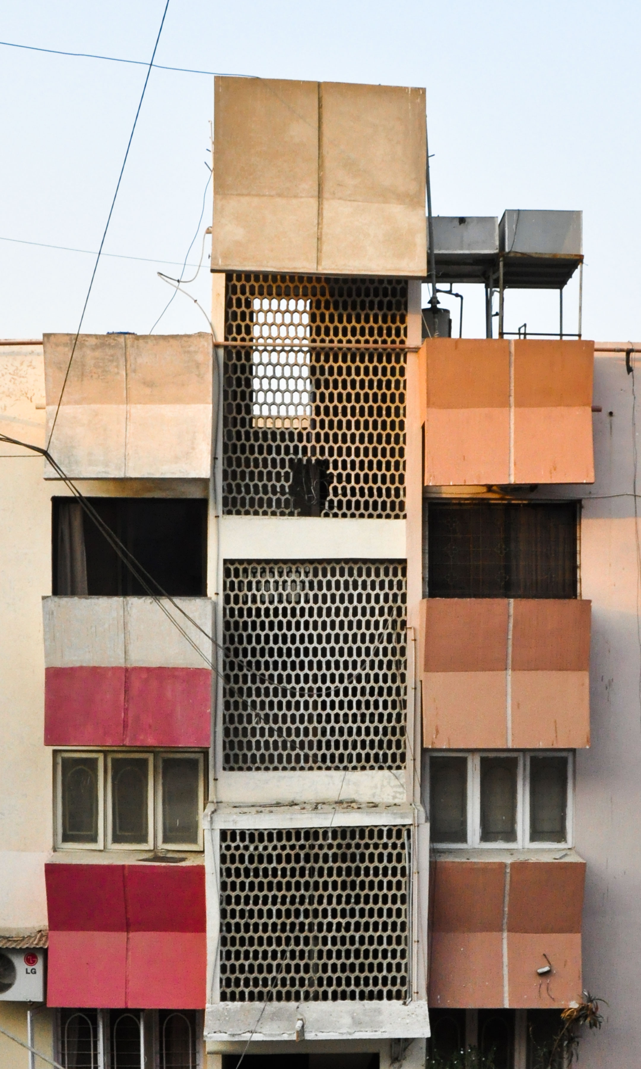 facade painted red by the Pathan neighbours